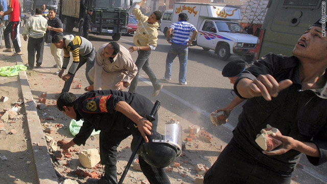 Egyptian police throw back stones at Christian demonstrators during clashes over a new Coptic church in Cairo.