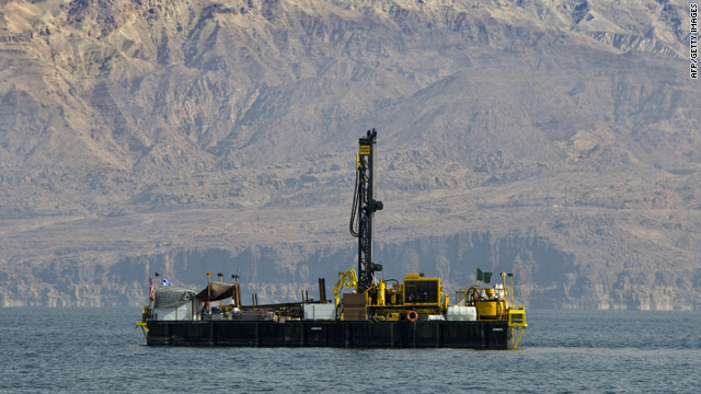 Scientists work to extract and examine the layers of sediment on the drilling platform in the Dead Sea.