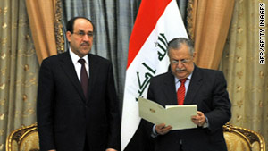 Iraqi President Jamal Talabani, right, names Nuri al-Maliki prime minister on Thursday.