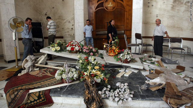 Iraqi Christians inspect the damage at Sayidat al-Nejat Cathedral in Baghdad after a deadly church siege on October 31, 2010.
