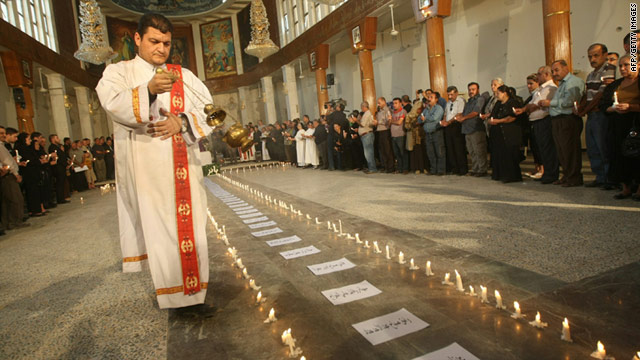 Christians pray at the Sayidat al-Nejat Cathedral  in central Baghdad on November 7, a week after 46 fellow worshippers taken hostage in the church by al Qaeda gunmen were massacred. Religiously rooted violence is causing increasing concern.