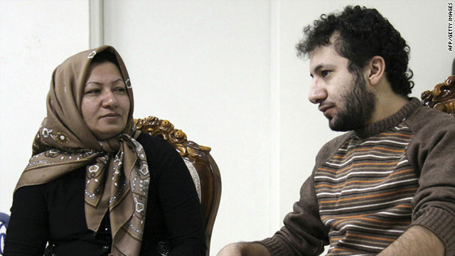 A picture released by Iran's state-run Press TV shows Sakineh Mohammadi-Ashtiani meeting with her son Sajjad.