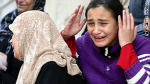 Relatives cry at the funeral for one of the 2 teens who were killed in the explosion.