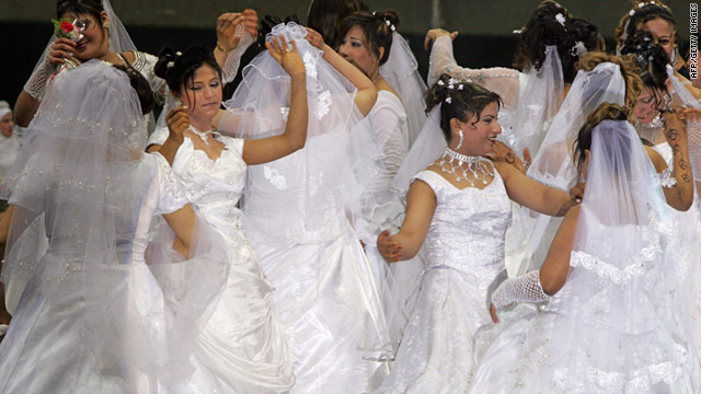 Newly wed brides dance at a mass wedding ceremony in Cairo, Egypt. Could talking more about sex help lessen Egypt's high divorce rate?