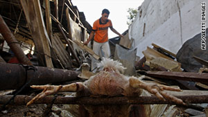 Palestinians inspect the damage  after an Israeli air strike earlier this month in southern Gaza Strip.
