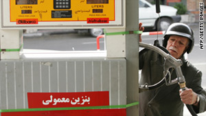 An Iranian motorcyclist pumps gas in downtown Tehran in 2006.