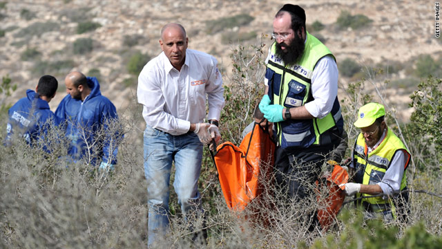 Israeli volunteers recover the body of American Kristine Luken on Sunday outside Jerusalem.