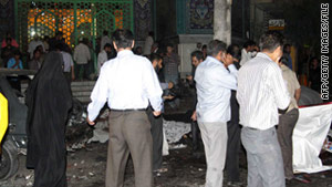 Iranians survey damage after July suicide bombings in Sistan-Baluchestan province that were claimed by Jundollah.