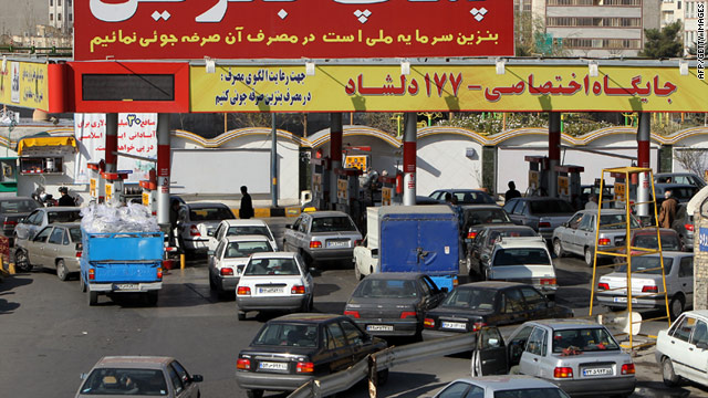 Iranian motorists line up at a gas station in Tehran on Sunday.