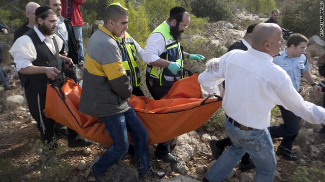 Israeli medics and volunteers carry the body of Kristine Luken near Mata, Israel, on Sunday.