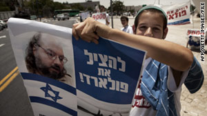 An Israeli youth demonstrator holds a picture of Jonathan Pollard, jailed for life in 1987 on charges of spying on the U.S.
