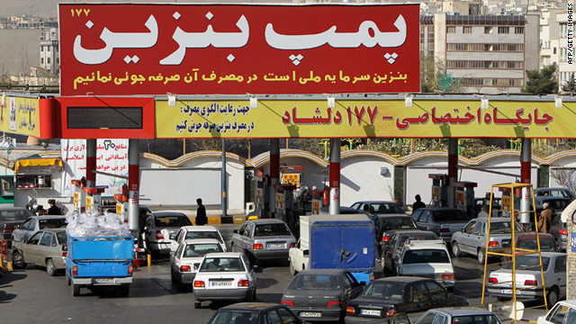 Iranian motorists queue for fuel on December 19, after the government cuts fuel subsidies to boost the country's economy.