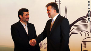 Turkish President Abdullah Gul, right, greets his Iranian counterpart, Mahmoud Ahmadinejad, on Thursday in Istanbul.