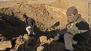 Palestinians inspect the damage to a tunnel destroyed during an Israeli air strike in Rafah, southern Gaza.