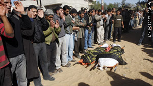 Palestinians pray over the bodies of two militants killed by Israeli forces in Gaza on Sunday.