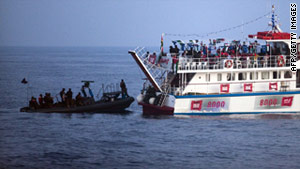 Israeli troops board a ship in a Gaza-bound aid flotilla in the Mediterranean Sea on May 31.