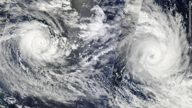 A NASA satellite image shows Cyclone Tomas over Fiji, right, and Cyclone Ului over the Solomon Islands, left.