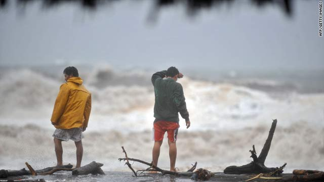 Two men watch heavy swells on Saturday in San Jose port, 110 kilometers south of Guatemala City, Guatemala.