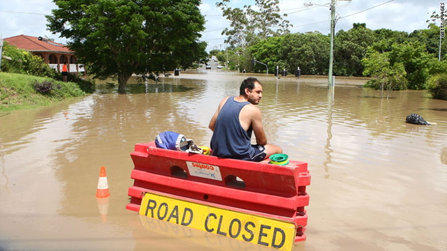 A resident of Fairfield fishes at the end of his street on January 12 in Brisbane, Australia.