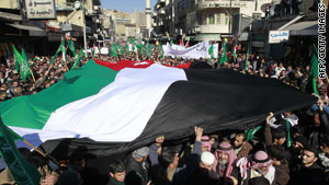 """Thousands protest in Jordan demanding """"bread and freedom,"""" and for the government to resign, on January 21."""