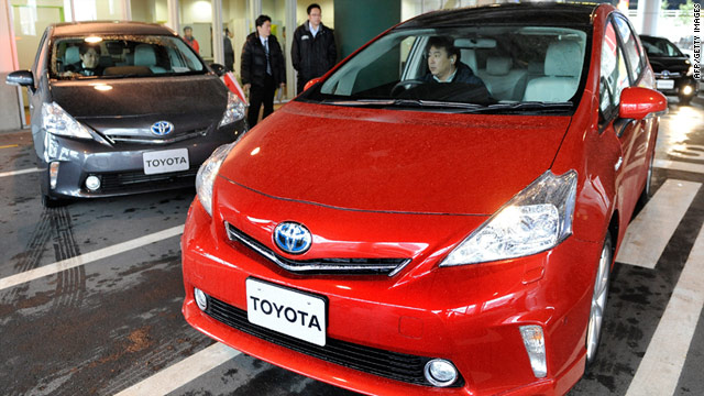 A journalist drives a new wagon-style hybrid Prius hybrid vehicle at a Toyota showroom in Tokyo on March 7, 2011.