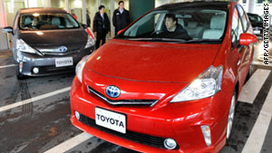 A journalist drives a Prius hybrid vehicle at a Toyota showroom in Tokyo on March 7.