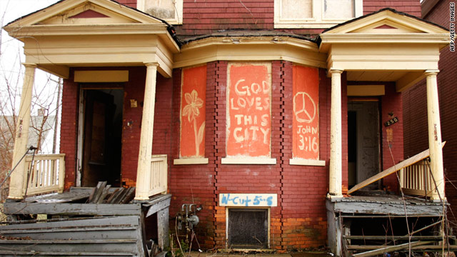 A house sits boarded up in Detroit where the population has declined 25% since 1910.