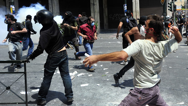 Protesters clash with riot police in Athens on June 28 after the Parliament voted in favor of a proposed bailout.