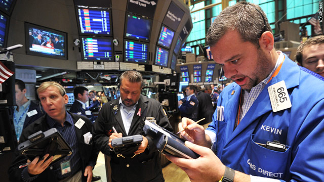 A trader working on the floor of the New York Stock Exchange just after the opening bell on August 5, 2011.