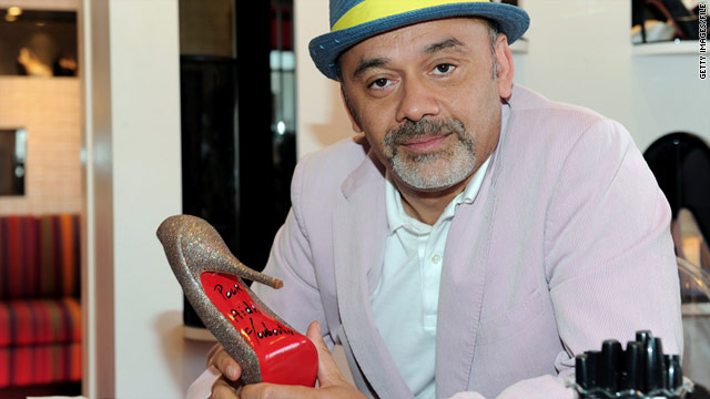 Designer Christian Louboutin autographed the red sole of a shoe he designed.