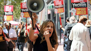 Protesters demonstrate outside a Verizon Wireless store in San Francisco on Wednesday.