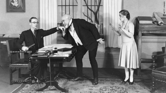 A man kisses the hand of his boss, in a scene from the play 'Fortunato',  19 October, 1928.
