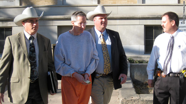 Sect leader Warren Jeffs is led into court Wednesday in San Angelo, Texas, where he is charged with bigamy.