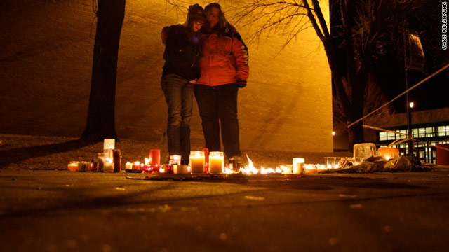 Students mourn at a candlelight vigil Wednesday night at Millard South High School in Omaha, Nebraska.