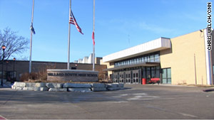 Flags fly at half-staff outside Millard South High School after Wednesday's deadly shooting.