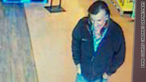 "Authorities released a photo of a second man ""possibly associated with the suspect."""