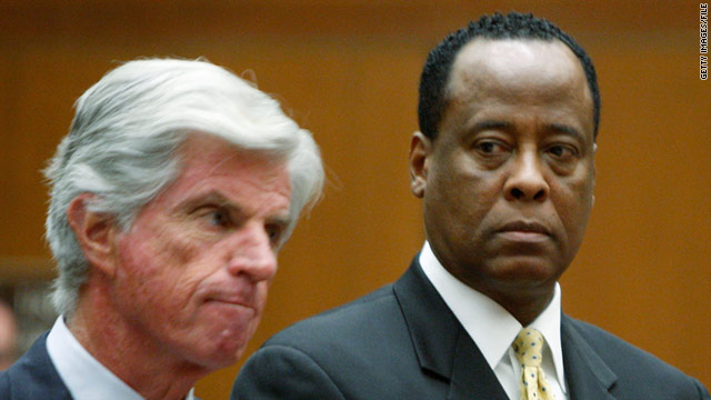 Dr. Conrad Murray, right (with defense attorney John Michael Flanagan), said Michael Jackson begged for propofol.