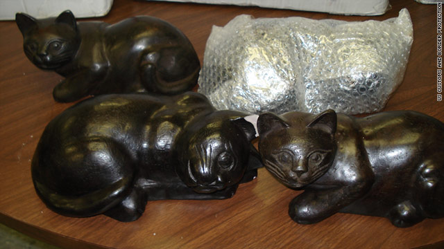 The 30 porcelain cats contained a total of 205 pounds of raw opium, U.S. Customs and Border Protection said Thursday.