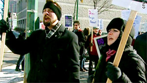 Protesters upset with the judge's ruling gather outside the Law Courts in Winnipeg on Friday.