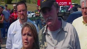 Karen and Dana Bobo ask for help in finding their daughter, Holly, who was seen being dragged toward woods.