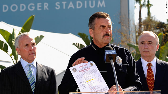 L.A.P.D. Chief Charlie Beck holds an artist's composite of those wanted in the beating of S.F. Giants fan Bryan Stow.