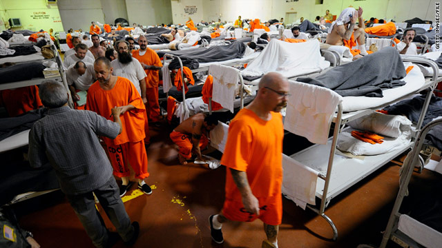 Inmates sleep on bunk beds in a gym modified to hold prisoners at the state prison in Chino, California.