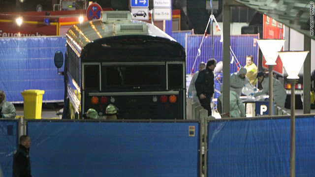 A dead body is carried away from a U.S. military bus after a shooting outside the Frankfurt Airport in Germany on March 2.