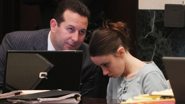 Casey Anthony confers with defense attorney Jose Baez, who hasn't said whether she will take the stand.