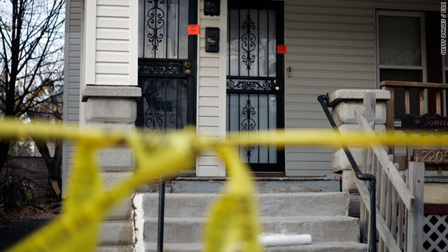 The residence of 50-year-old alleged serial killer Anthony Sowell is sealed off with police tape in 2009.