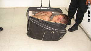 Police say Juan Ramirez Tijerina tried to escape in this suitcase with the help of his wife, Maria del Mar Arjona.