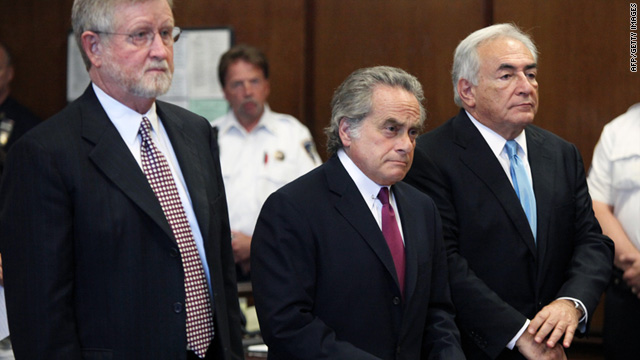 Dominique Strauss-Kahn, right, stands with his lawyers Benjamin Brafman, center, and William Taylor during a hearing.