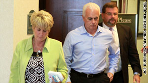 Cindy and George Anthony leave court on Tuesday after their daughter, Casey, was acquitted on murder charges.