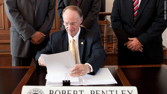 Gov. Robert Bentley signs Alabama's immigration legislation June 9. The law is set to take effect in September.