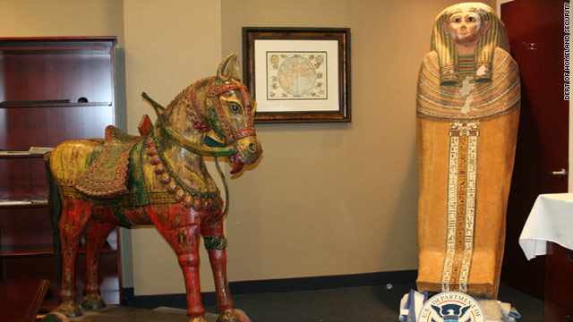 Antiquities recovered from the smuggling ring included a statue of a horse and an Egyptian sarcophagus.